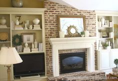 Love the shelves on either side of the fireplace...will need something similar for the new house!