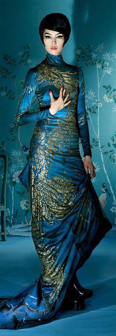 Alexander McQueen Autumn 2006. Asian chinoiserie wallpaper.  Retro hair and makeup.  Editorial.
