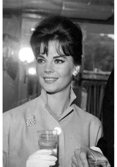 Natalie Wood emanated such class....the hair, pin, gloves, collar....