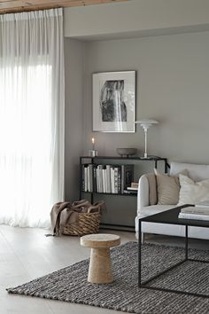 Soft grey walls and diffused light in a minimalist living room. Love the thin framed black shelving unit and how it connects with the thin framed square coffee table. wall Beige and grey in the living room Farm House Living Room, Minimalist Living Room, Grey Walls, Beige Living Rooms, Living Room Grey, Rustic Living Room, Lamps Living Room, Living Room Decor Gray, Living Decor