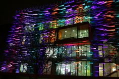 "Here's an interesting use of aluminium louvers and LED technology recently installed at Moorfields Eye Hospital in London. The new building, designed by architects Penoyre & Prasad, is illuminated on the south side using RGB color changing LED lighting supplied by Light Projects and Tryka. The LED lighting illuminates the façade by casting light on the underneath of the freely-placed, folded aluminium louvers, which the designers have nicknamed ""seagulls""."