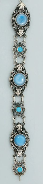 An arts & crafts aquarmarine brooch by Bernard Instone, a moonstone necklace and a bracelet The brooch designed as an oval mixed-cut aquamarine with pierced scroll and applied vine leaf surround; the necklace composed of alternating oval and square panels each set with a single moonstone to chain-link connections; the bracelet composed of three single closed-set foiled gem panels with foliate connecting links The Brooch signed B.I for Bernard Instone, the necklace; bracelet signed T.M. & Co