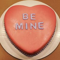 Be Mine Valentine's Day cake.  Chocolate cake filled with a Strawberry and White Chocolate Ganache covered in a strawberry flavored fondant by Coastal Confections Richmond Hill GA creating and serving cakes for Savannah GA, Tybee Island GA, Hinesville GA, St Simons Island GA.