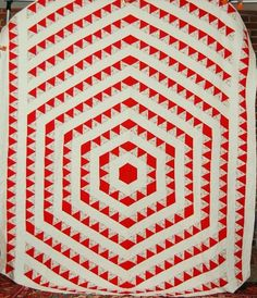 1930's red and white concentric triangles quilt spotted at Ebay