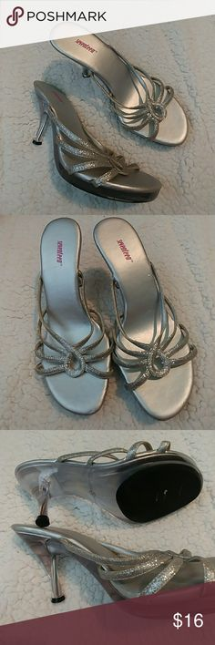 "Seventeen Inc silver strappy heels 7 Seventeen Inc silver glitter strappy slip on, slides, mules heels size 7. Bottom & heel are clear acrylic-like, heel approx.3"". Great for a wedding or special occasion. Seventeen, Inc. Shoes Heels"