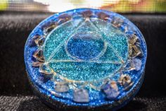 Sodalite Orgonite - Speak your truth - Deeper Spiritual Understanding of Truth & Idealism - Flower of Life    Here are some common uses/benefits for Orgonite:     -Eliminate EMF (smart meters, wifi, 4g electro-smog)  -Transmutes deadly energy to positive life force energy  -Enhance plant growth  -Structure food and water-food keeps longer near orgonite  -Balance the environment  -enhanced psychic ability  -helps anchor in higher dimensional energies    Below are some ideas for ways you can…