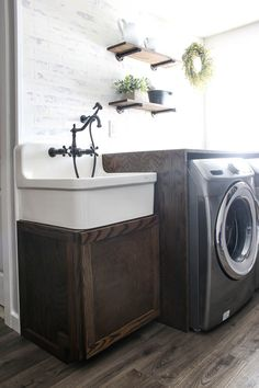 Are you looking to add a fun wood DIY project to your laundry room? Then you''ll love this article! Not only did we share with you images of our new beautiful wood sink cabinet, but we also included plans that will inspire you to build one of your own! #farmhouselaundryroom #sinkcabinet #DIY #woodprojects Farmhouse Utility Sinks, Farmhouse Laundry Room, Diy Projects Using Wood, Woodworking Projects Diy, Wood Sink, Faux Brick Walls, Industrial Pipe Shelves, Oak Trim, Laundry Room Cabinets