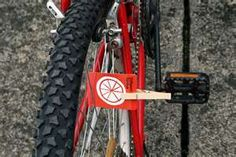 this sound was great: clip a baseball card/playing cards to the bicycle spokes. we did it often with playing cards.