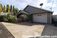 New Price Alert! 1074 NE GRANDVIEW DR- Check out this amazing, energy efficient home centrally located in Roseburg OR with city, mountain and valley views! Wonderful interior features include new flooring downstairs, fresh paint throughout, high ceilings, an open kitchen/living room, modern fixtures and lighting, plus 3 bedrooms and 2.5 bathrooms.