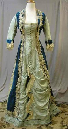 """From eBay: """"1874 Princess Velvet & Silk Bustle Gown:This bustle gown is from a very short period of time.  It is one piece.  These became popular in 1874 and the design only lasted a few years.  This dress looks like a Monet painting.  It is made of velvet, silk fabric, beads, and blond lace.  The bust is 34, the waist is 28, the skirt length in front is 43, and the shoulder is 13.5.  This gown would be for study as it is too fragile to wear.  With proper conservation it could be used for…"""