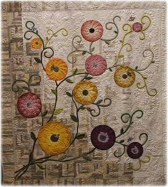 createcreatively:    Woven Wind Flowers by Delores Keaton and quilted by Sandi Wagner.  The quilt is made of recycled quilt blouses from thrift shops.