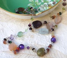 Green garnet, moonstone and gemstone necklace with handmade sterling silver clasp.