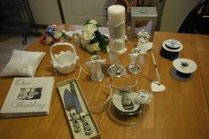 A Slew of Wedding Supplies for only $30!  At our Ebay Store.... Unity Candle, Flower Basket/Ring Pillow, 2 Tiaras, Cake Topper, Album, 2Bouqets, Cake Knives, and more!  Local pickup available in Worthington.