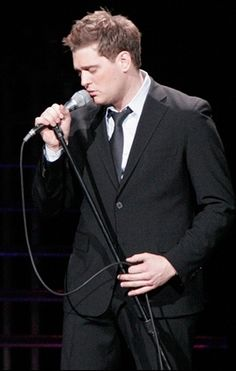 Michael Buble. Oh my, he could sing to me all day every day and I would never get sick of it :)