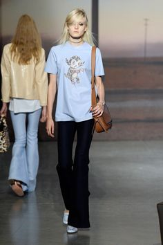 The collection he sent out on Day 1 of NYFW was American — true to brand DNA — yet filtered through Vevers' British lens. So your basic tees, sport coats, skirts (mostly mini) and dresses had a certain cheek to them. This was in no small part due to the Gary Baseman characters printed front-and-center on shirts or intarsia-d into sweaters.    - HarpersBAZAAR.com