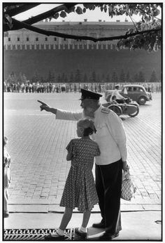 SOVIET UNION. Moscow. Red Square, facing the Kremlin's brick wall. 1954. Old railway worker. by Henri Cartier-Bresson