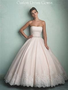 Beautiful Tulle Wedding Ball Gown with Linear Strapless Neckline, Ruched Fitted Bodice with Swarovski Crystal Beaded Waistband, Gathered Skirt with Lace Hemline, Chapel Train, Ruched Back with Covered Buttons to Hem and Hidden Zipper Close. #champagneweddingdress #blushweddingdress #sayyestothedress #tulle #lace #newweddingdress #customweddinggown #customdress #beautifulwedding #chapeltrain #ballgown #crystalwaist