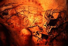 Paleolithic Cave Paintings -- Red ochre cave painting 	Vallon-Pont-d'Arc, France 15,000-18,000 BC