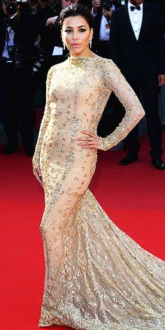 EVA LONGORIA wows again in a head-turning, intricately beaded Zuhair Murad creation and major Damiani earrings at the premiere of Le Passé at  The Cannes Film Festival 2013