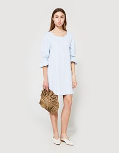 Shift dress from Stelen in Blue. Scoop neckline. Three-quarter sleeves. Gathered elastic cuff with flounce detail. Straight hem. Lined.  • Poplin shell, chiffon lining • 65% rayon, 35% polyester shell • 100% rayon lining • Hand wash cold