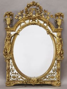 22: Louis XVI style carved gilt mirror surmounted by : Lot 22