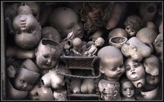 Scary looking heads in a window in Rome, Italy     Check this out!