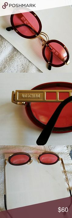Moschino sunglasses Rose-colored lenses, brass hearts around frame. Very sturdy, lots of fun! Moschino Accessories Sunglasses