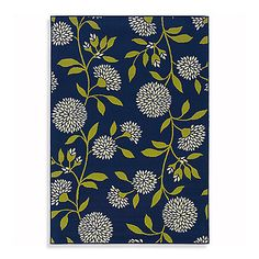 Accent hallways, entryways, decks and more with this rug, and its rich, floral-inspired design.