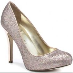 """VANKA TRUMP PINKI BRIDAL SHOES  $98.00  Gorgeous multi-tonal glitter embellished pumps make every outfit better. The classic round toe and sleek platform design make these pumps a versitile and must have shoe. The heel is an offset solid metallic for interest. Heel measures 4"""" with a 1/4"""" platfrom front."""