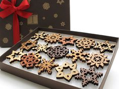 These tiny wooden snowflake ornaments are little treasures that will brighten up your holidays. Packaged for gift giving, or a great little