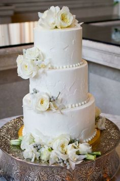 I love the way the icing looks like the wall finishing. With a tan underlay it would be perfect for a tuscan wedding. And deff something other than the flowers... They gots to go ivory