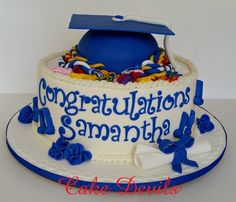Graduation cake with flowers, music notes, and honor cords