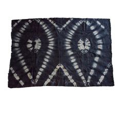 """Bogolanfini, which translates to """"mudcloth"""", is a hand-dyed cotton textile crafted predominantly by the Bamana people of Mali. Using fermented mud and a solution of boiled plant leaves, artisans create meaningful designs on the field, which is pieced together from long strips of woven cotton. These large pieces of bogolanfini make very dramatic throws or wall hangings. #artisan #handmade #mudcloth #bogolanfini"""