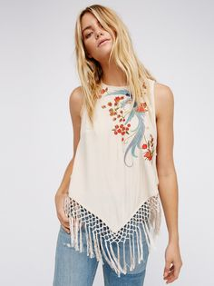 Love Birds Fringe Top | Pretty tank featuring gorgeous nature-inspired embroidery with eye-catching bead embellishments throughout. Adjustable ties down the open back add a delicate femme detail. Fringe hem completes the soft look. Lightweight, semi-sheer fabrication.