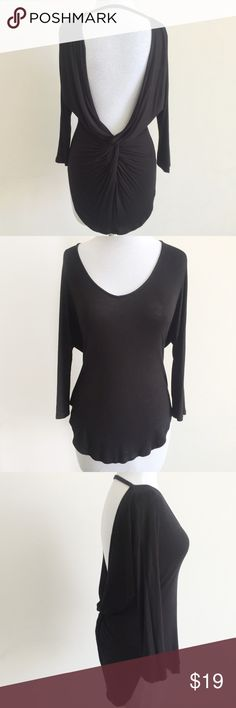 Black 3/4 Sleeve Sexy Low Back Knot Backless Top S Beautiful black top features boatneck in front, three-quarter length sleeves, sexy low back with knot detail and rounded hem. Slightly longer in back. Lightweight, draped fabric.   • size tag missing but fits like a small  • 97% rayon, 3% spandex  • gently worn only once and in great condition Tops