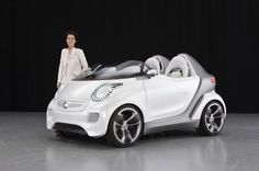Smart Forspeed, green car, build without a roof - the inside is waterproof, but it comes with a tonneau top to use in case of rain.