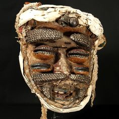 """Ngere Mask with four horns; many tacks; old skin and cloth 15 1/2"""" / 39.4cm, Côte d'Ivoire : Collected by Jean Pierre Hallet"""