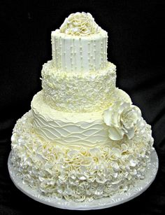 This cake is decorated in a mixture of fondant, icing, and white chocolate.  the flower is made of gumpaste.