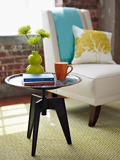 Whip up a one-of-a-kind side table in a jiffy. Choose an oversize decorative serving tray -- pick up a trendy one from a home decor store or repurpose a vintage flea market find. With a dab of construction adhesive, glue the tray to the top of an adjustable-height stool for a handy table you can raise and lower.