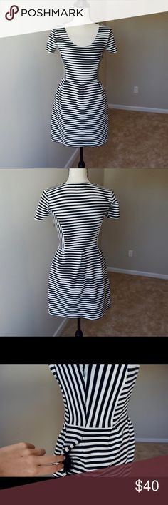 Madewell dress Excellent condition, stretchy fabric. Black and white strips. Side zipper and pockets. Madewell Dresses