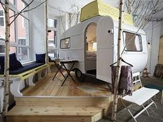 Glamping - without even leaving the building!  This is Huttenpalast, a funky new budget hotel in Berlin made from recycled, revamped campers.