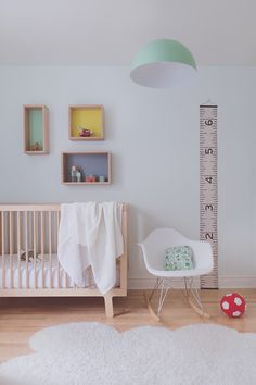 Modern neutral white nursery with pops of pastel colour