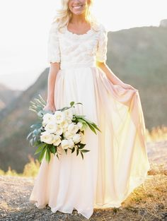 Feminine Charm - Modest Wedding Gown. One of the most beautiful wedding dresses I have seen! This would be perfect for my dream wedding. looks very country chic ;)