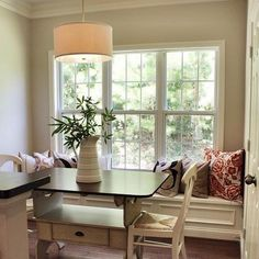 I love this simple and cozy breakfast nook - a wonderful amount of light streams in through the triple side-by-side windows and the molding on the base of the built-in banquette is great   Courtesy of Erika Ward