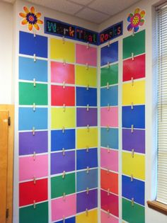 displaying student's work - laminated pieces of construction paper and clothes pins with thumb tacks hot glued to back