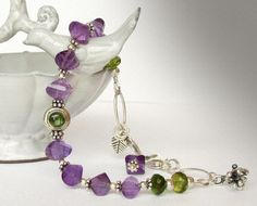 Amethyst and Peridot Bracelet by jQjewelrydesigns,