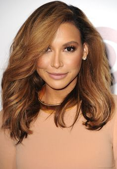 Earlier this year, Kim took on a new haircut shape: the long, layered lob. Naya was soon to follow, chopping her locks to this flattering length.