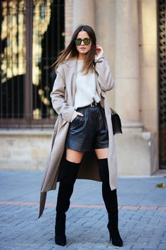 Zina Charkoplia of Fashion Vibe wears her coat with thigh-high boots, and sexy leather shorts. Balance is key. // The Sexy Way To Wear Your Coat