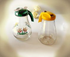 Vintage 1950s Glass Syrup Dispensers, glass syrup pitchers : Dripcut and Federal Glass Corp. Green and Yellow  caps handpainted flowers.