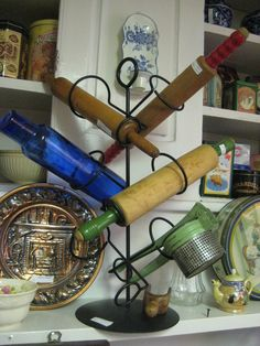 Roll Out A Useful Idea For Displaying Vintage Rolling Pins  (note the very collectable cobalt blue pin)